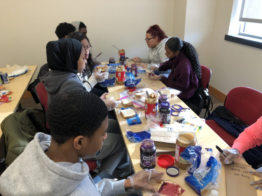 Youth Action and TeenSHARP students preparing PB&J sandwiches